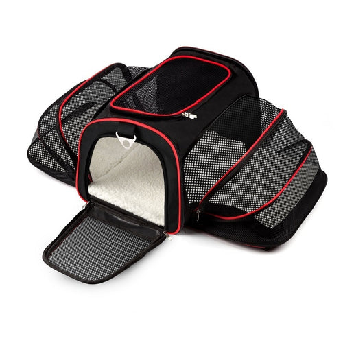 Expanding cat or small dog carrier  - sides unzip to extend the available area. Ideal for under airplane seats or long train or car journeys for extra comfort.