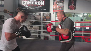 Joshua Francis doing pads with Shane Cameron