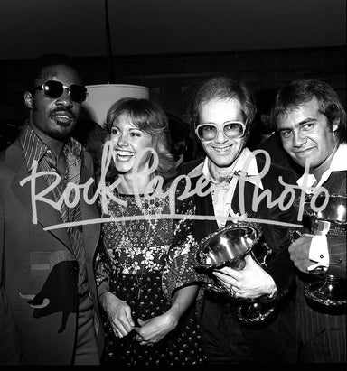 Stevie Wonder, Olivia Newton-John, Elton John & Be