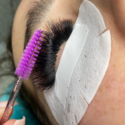 How do you unstick eyelash extensions from bottom lashes?