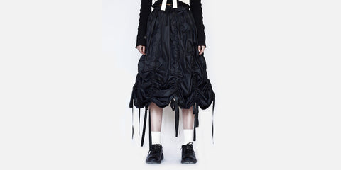 Museum of Friendship 'Drawstrip Skirt'<br> 'Year': 2017 – 'Material': 100% Polyester – 'Made in': China – 'Brand': Museum of Friendship is a London based brand that launched in 2014. It was founded by Tianmo Wang, a Central Saint Martins graduate, who became the second runner up of the LOreal prize
