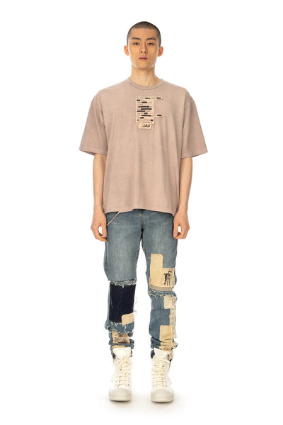 Val Kristopher 'Book Page T-Shirt' and 'Multi Patched Denim', styled with Rick Owens DRKSHDW sneakers
