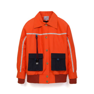 Museum of Friendship | Short Oversized Waterproof Jacket Orange - Concrete