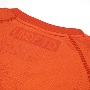 adidas | x UNDEFEATED Knit T-Shirt Orange - Concrete