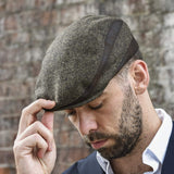 Men's brown flat ivy hat on model