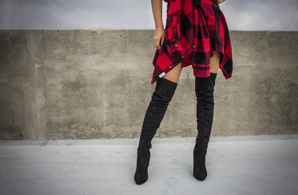Woman wearing over the knee boots