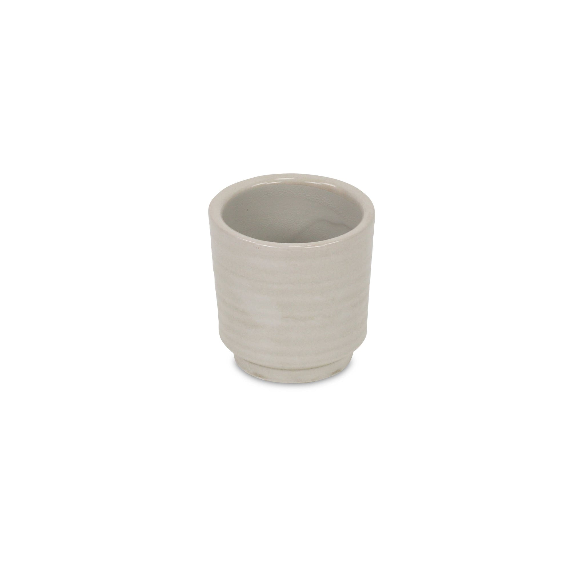 Off-white ripple pattern ceramic planter