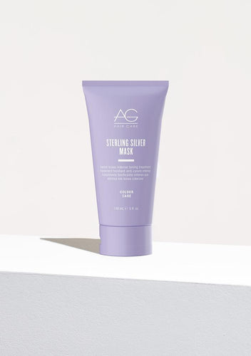 AG Hair Sterling Silver Mask is an intense and nourishing formula that eliminates brassy, yellow tones from blonde and silver hair with its dark violet base. Shea butter and Abyssinian oil add instant shine and softness while helping reduce and prevent breakage. Infused with AG's exclusive CARE Complex, providing both UV and free radical protection to help extend the life of hair colour.