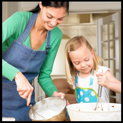 kid helping mom in kitchen