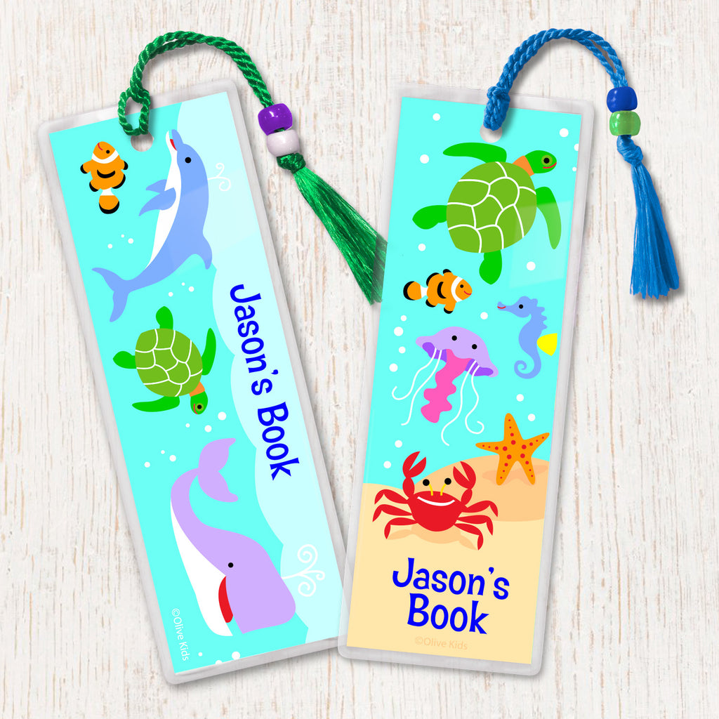 Kids personalized bookmarks with dolphin, sea turtles, whale  and other sea creatures in an underwater scene, decorated with tassel and beads.