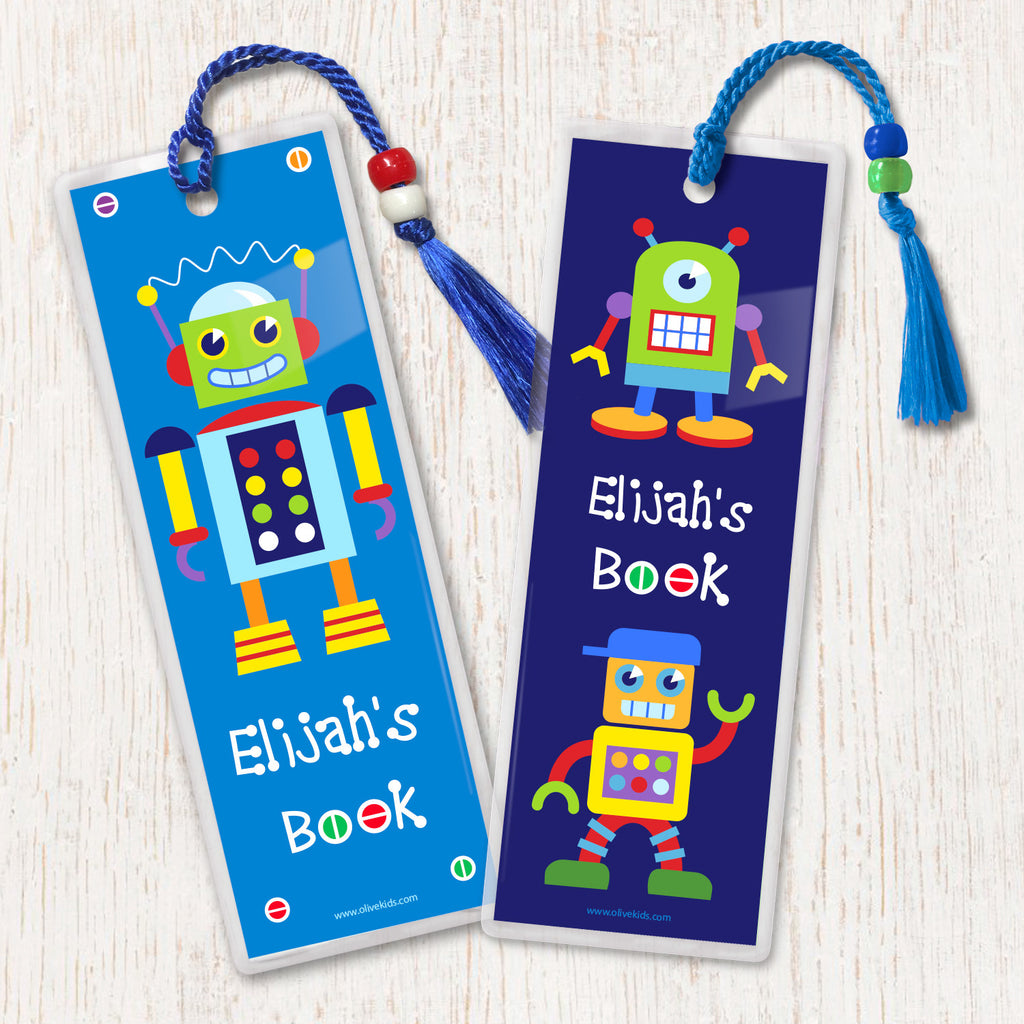 Kids personalized bookmarks with colorful robots on blue background, decorated with tassel and beads.