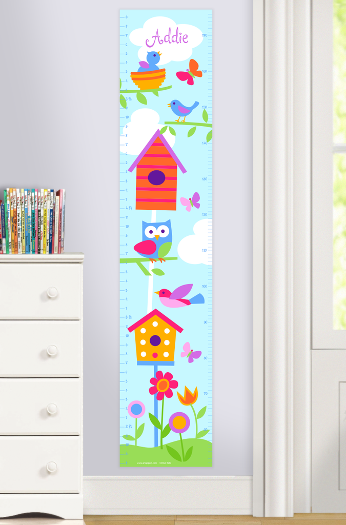Growth Chart with birdhouses, flowers, flying bird and baby birds in nest, on a sunny day background. Personalized with child's name at top.Photographed in a room setting.