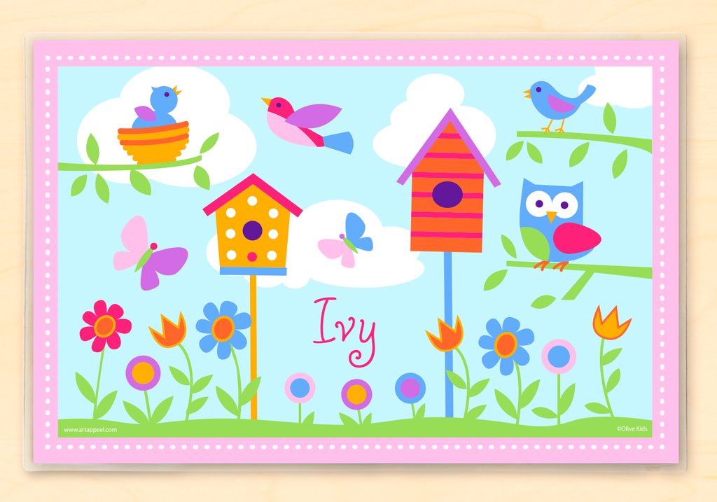 Personalized Kids Placemat with birds, birdhouses, bird nests and trees on a blue sky