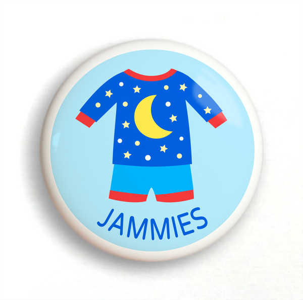 Ceramic drawer knob, blue pajamas with yellow moon and stars on a light blue ground with the word jammies written below