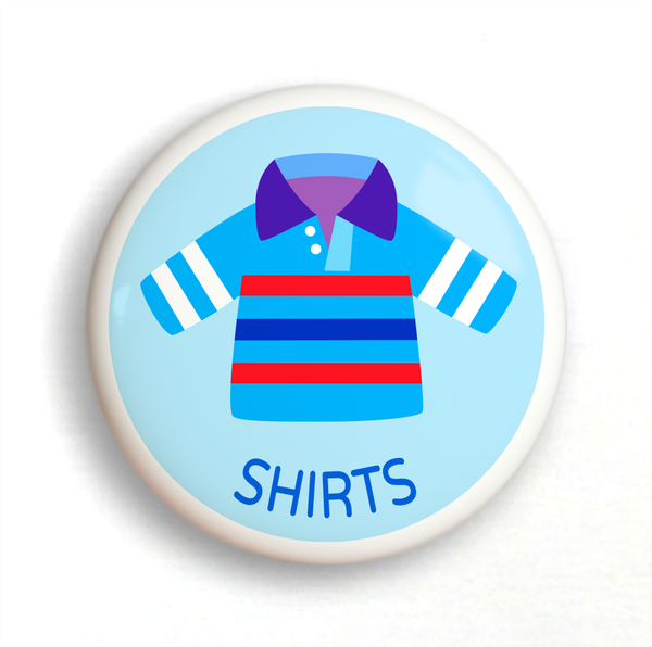 Ceramic drawer knob with a striped shirt on a light blue ground with the word Shirts written below