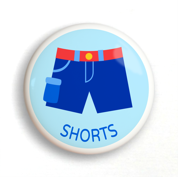 Ceramic drawer knob with boy's shorts on a light blue ground with the word shorts written below