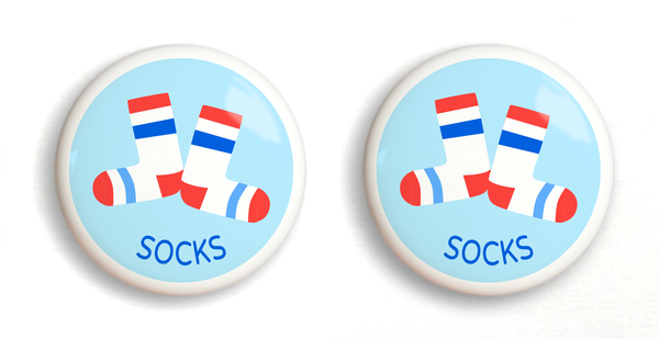 2 ceramic drawer knobs white socks with stripes on a light blue ground with the word socks written below