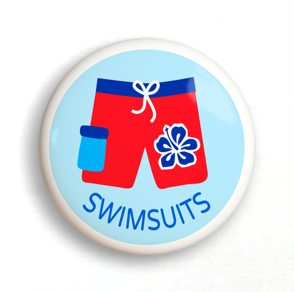 Ceramic drawer knob with boys Ceramic drawer knob on a dresser, with red boys bathing suit on a light blue background with the word swimsuits written belowbathing suit on a light blue background with the word swimsuits written below