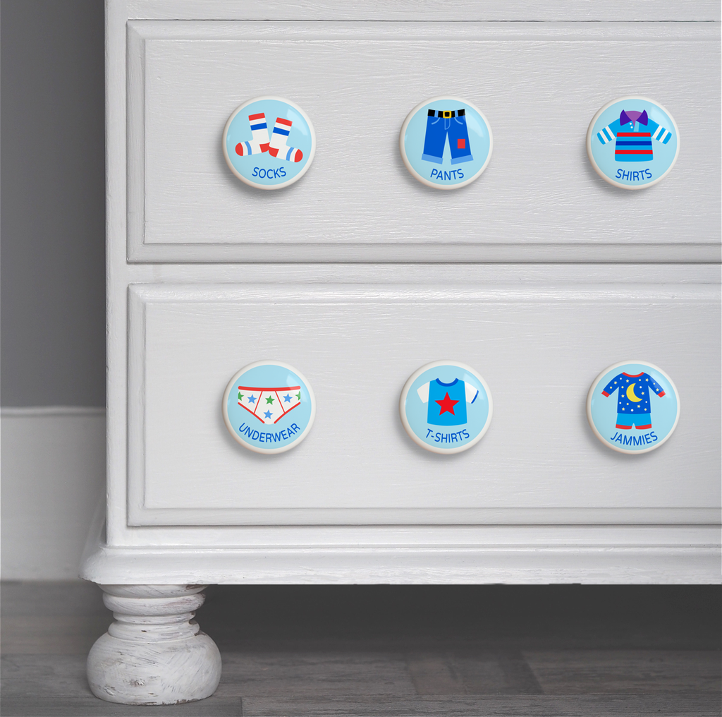 Boys ceramic drawer knob on a dresser set of 6, one each of socks, underwear, pajamas, shirts, t-shirts, and pants