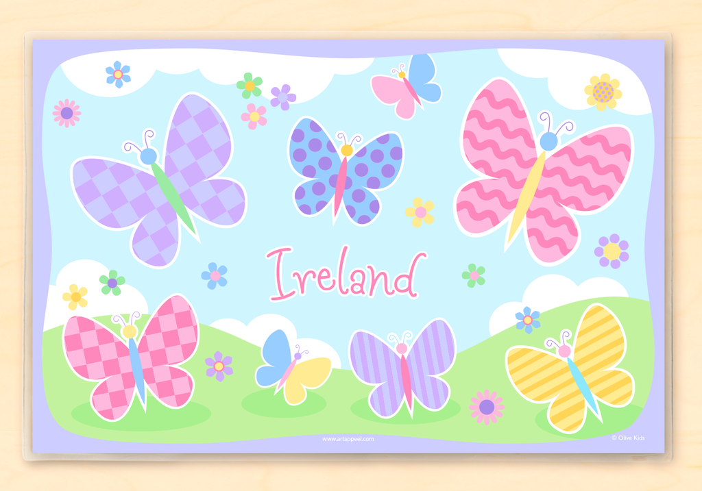 Personalized Kids Placemat with soft color butterflies and flowers on sky and grass background