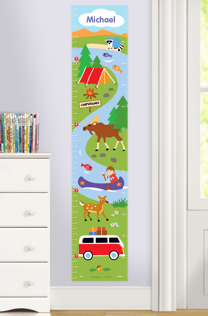 Personalized growth chart with camping scene of tent, trees, moose, stream with canoe and camping van. Personalized with child's name at top. Photographed in room scene.