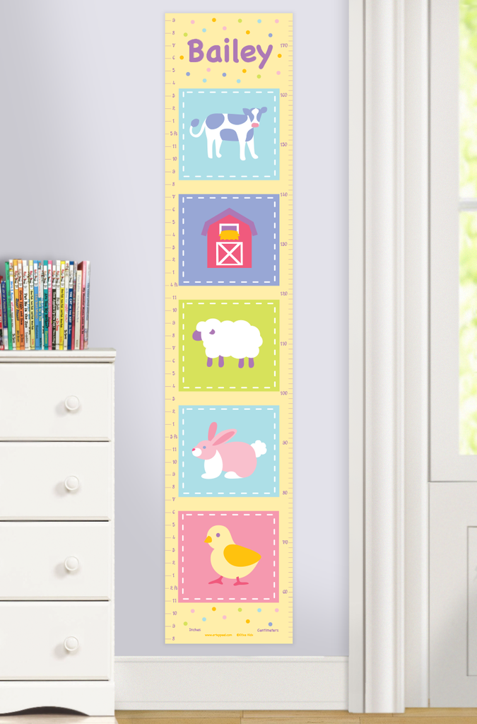 Personalized Farm growth chart with baby cow, lamb, bunny, chick and barn in color squares. Personalized with child's name at top. Photographed in room scene.