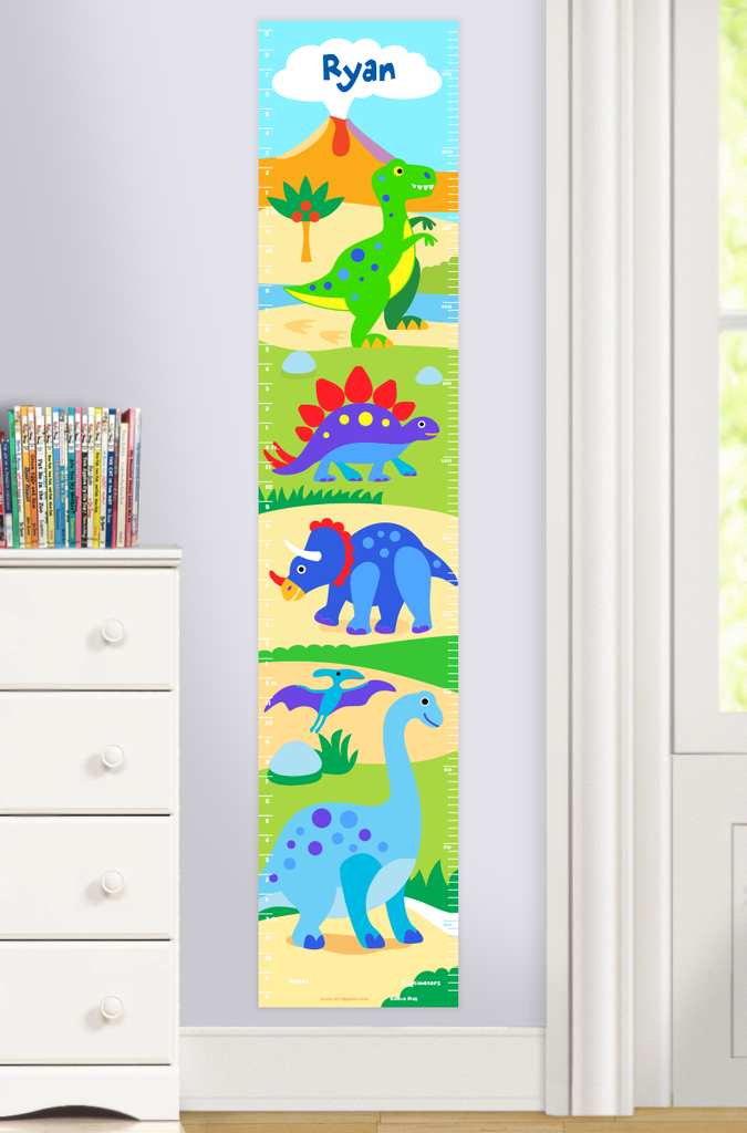 Dinosaur Land Personalized  Growth Chart with multi color dinosaurs in a prehistoric scene. Personalized with child's name at top. Photographed in a room scene.