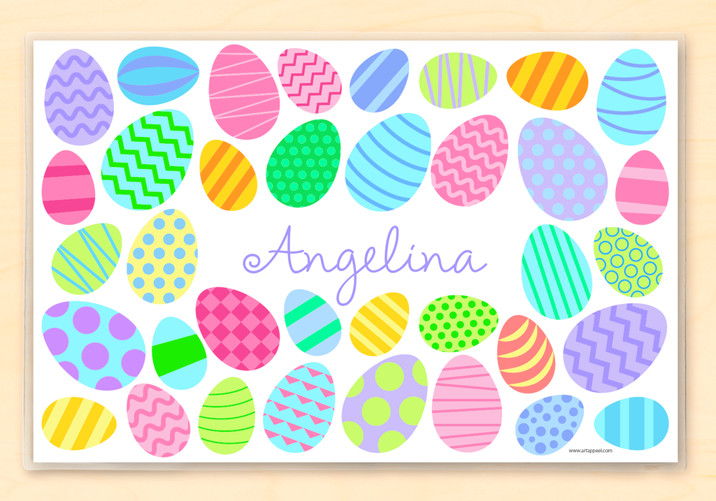 Colorful decorated Easter eggs on a white background.  Child's name is featured in the center.