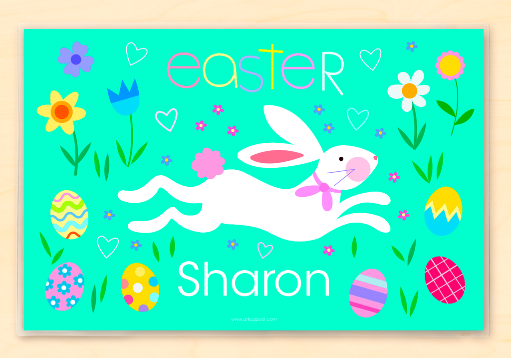 Personalized Easter Bunny Placemat for kids with white bunny running across blue green ground, with pastel color easter eggs and flowers