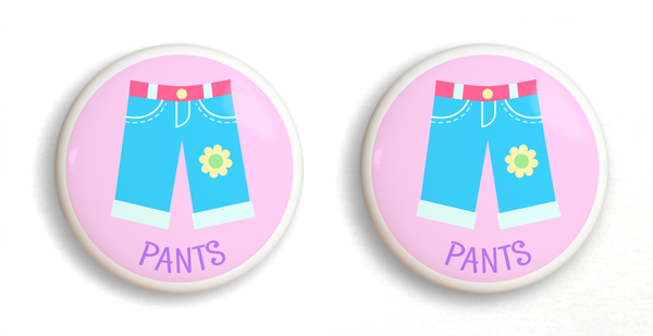 2 Ceramic drawer knobs, girls pants on a pink ground with the word Pants written below