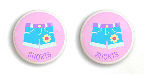 2 Ceramic drawer knobs, girls shorts on a pink ground with the word shorts written below