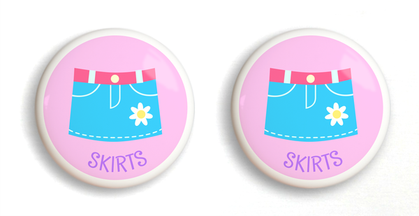 2 Ceramic drawer knobs, Girls skirt on a pink ground with the word Skirts written below