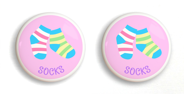 2 Ceramic drawer knobs, striped socks on a pink ground with the word socks written below