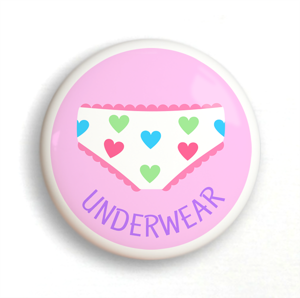 Ceramic drawer knob on a pink background with the word Underwear written below