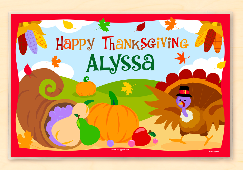 Thanksgiving placemat features a Turkey, a horn of plenty with autum vegetables, in an autumn scene.  Personalized with child's name.