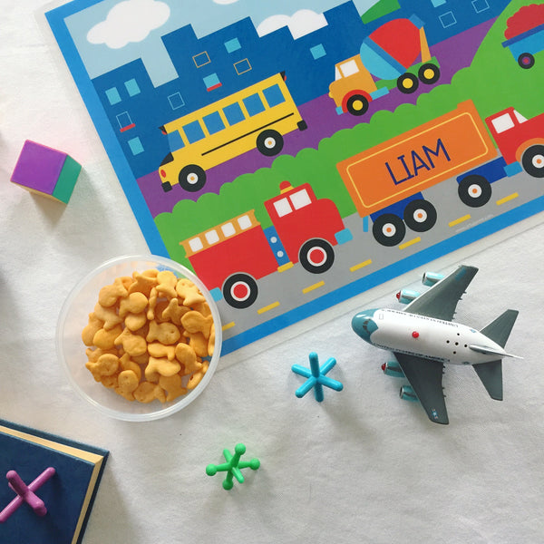 Personalized kids boys transportation placemat with trucks, airplane, bus, firetruck, and tractor