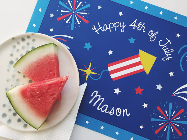Happy 4th of July patriotic personalized kids placemat with a blue background, fireworks, firecracker, and watermelon slices