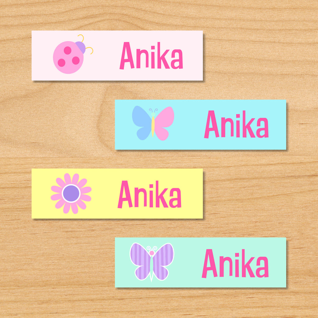 Butterfly garden kids spring personalized name waterproof labels with butterfly, flower, and ladybug in pastel colors on pink, blue and yellow backgrounds