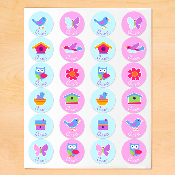 Personalized round lables with birds, birdhouses and bird nests on light blue and pink backgrounds