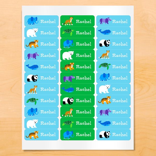 Personalized kids lables with pandas, whales, polar bears and other animals on blue and green backgrounds