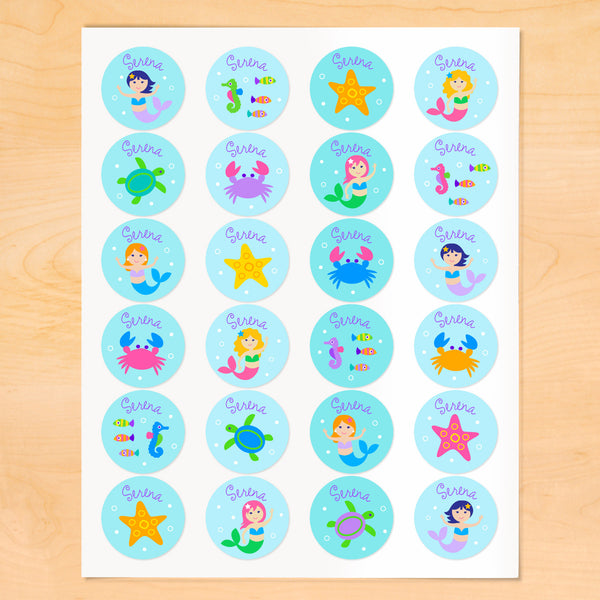 Personalized kids round lables with mermaids, starfish and sea creatures on soft blue backgrounds