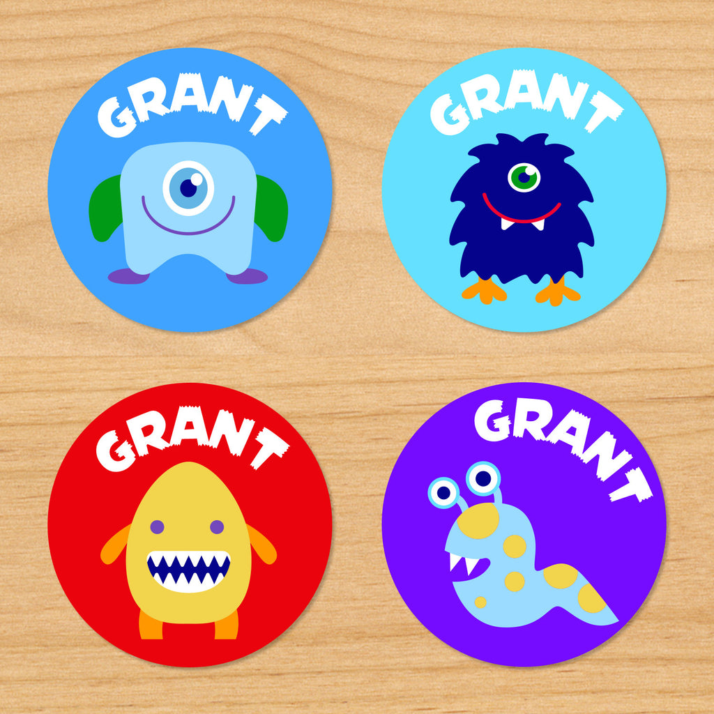 Monsters personalized kids round name labels with colorful monsters on red, blue and purple backgrounds