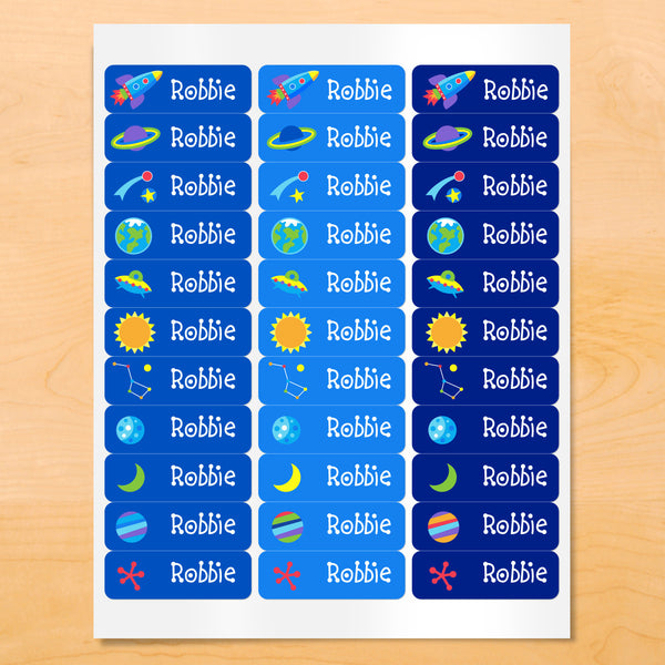 Personalized kids lables with rocket ships, planets, and stars on blue backgrounds