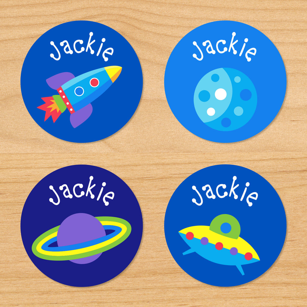 Out of this world space kids personalized round waterproof boys name labels with rocketship, UFO, and planets on blue space galaxy background
