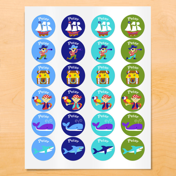 Personalized kids Pirate themed round labels with pirate ship, treasure chest and nautical images on blue and green backgrounds