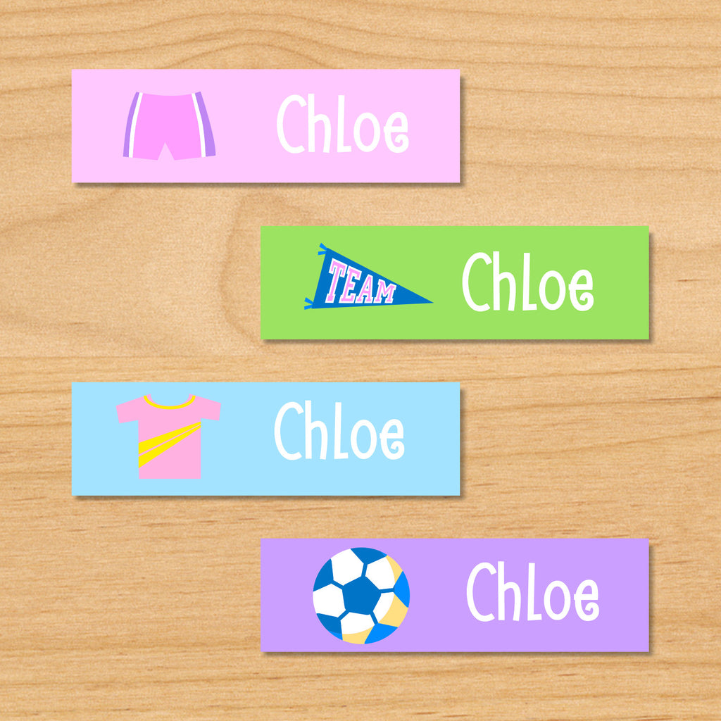 Soccer girls personalized kids mini waterproof labels with soccer shorts, pennant, soccer jersey, and soccer ball on pink, green, blue and purple backgrounds