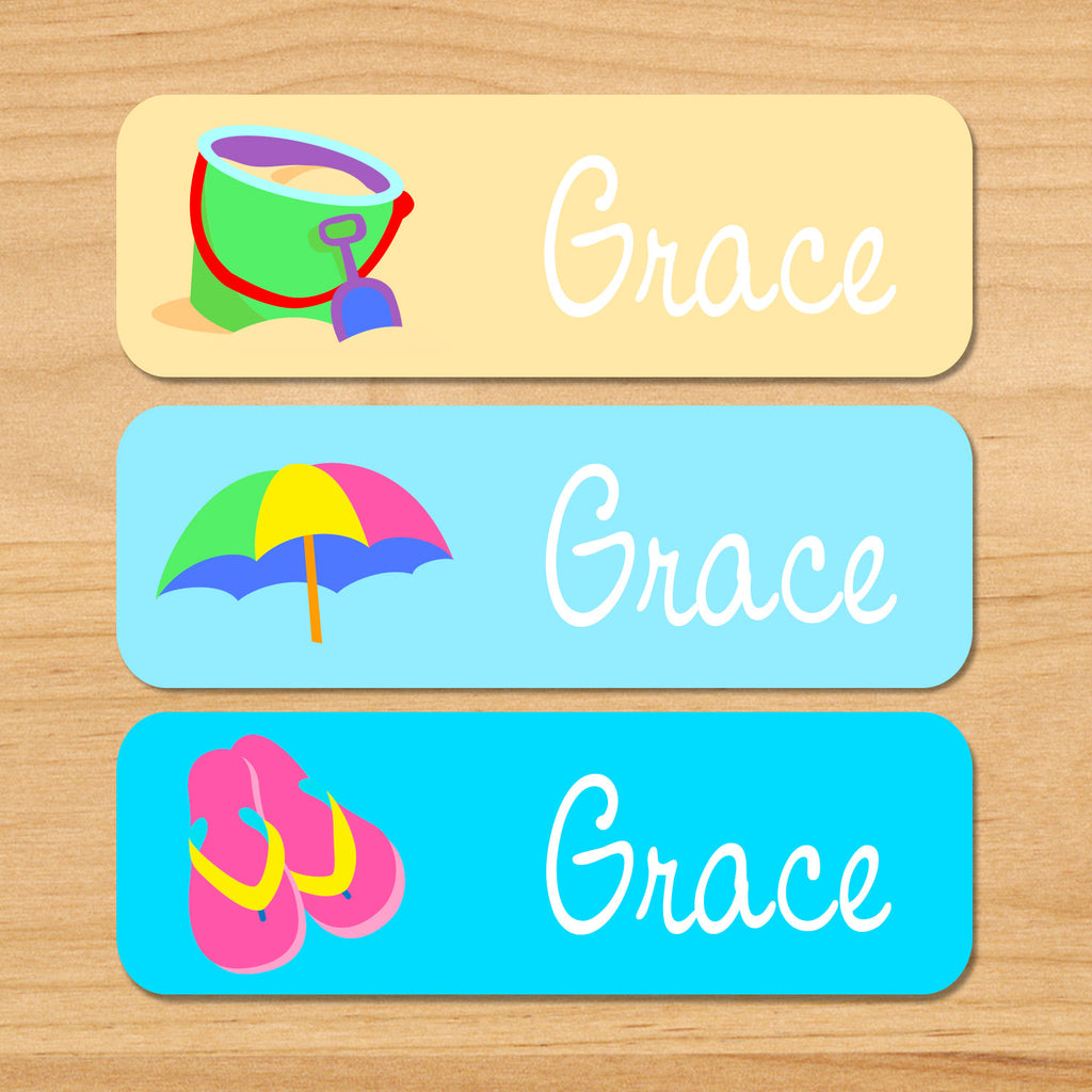 Summer beach personalized kids name waterproof labels with sand, bucket, umbrella, and flipflops on sand and blue background