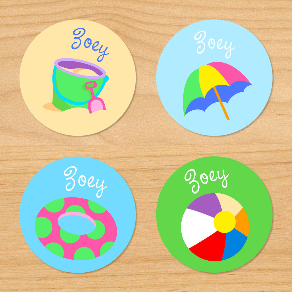 Summer beach personalized kids name round waterproof labels with pail, shovel, sand, float, umbrella and beachball on sand, green and blue ocean background