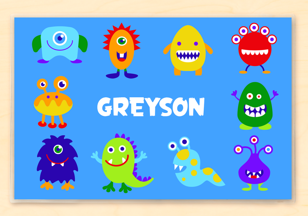 Personalized Kids Monster Placemat with happy, colorful, little monsters on a blue backgroun