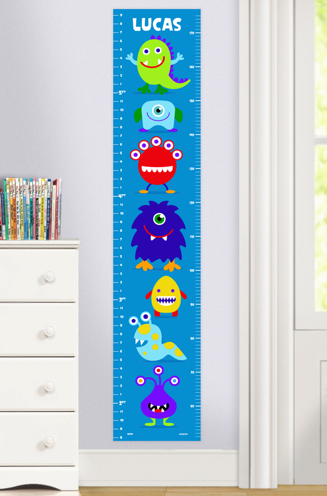 Monsters Personalized Growth Chart with colorful little monsters on a blue background. Personalized with child's name on top. Photographed in room scene.